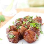 GLAZED MEATBALLS ON A PLATE GARNISHED WITH CILANTRO