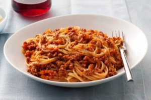This, by far, is one of the best spaghetti recipes I have come up with! This crockpot meat sauce simmers all day to perfection! It's such an easy family dinner but can also feed a crowd at a casual dinner party. This meat sauce makes a great freezer meal as well! Freeze up a batch and have a delicious pasta dinner ready in under 30 minutes! #cleaneating #pastarecipes #spaghettirecipe #bestmeatsauce