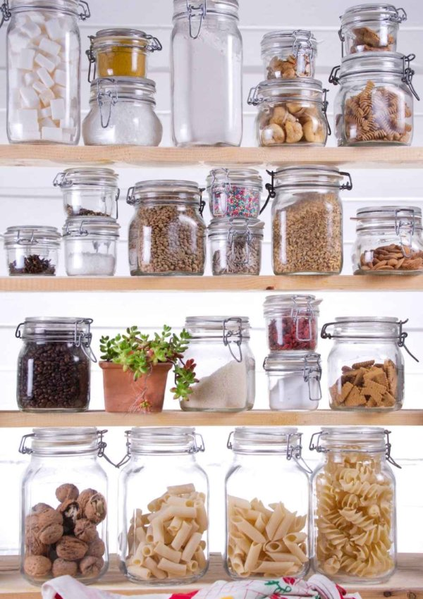 shelves with jars of kitchen food essentials