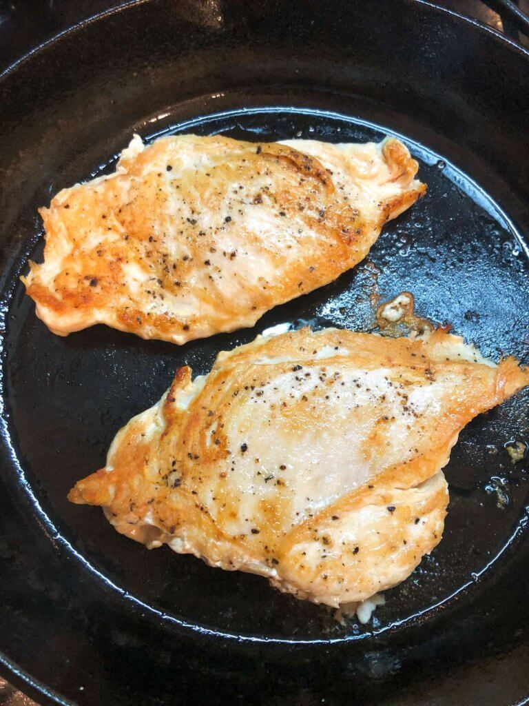CHICKEN BREASTS COOKING IN A PAN