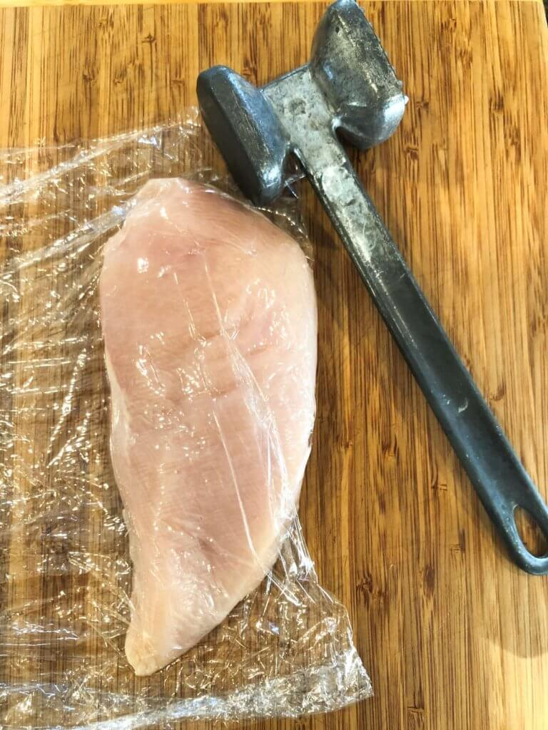 RAW CHICKEN BREAST WITH MALLET