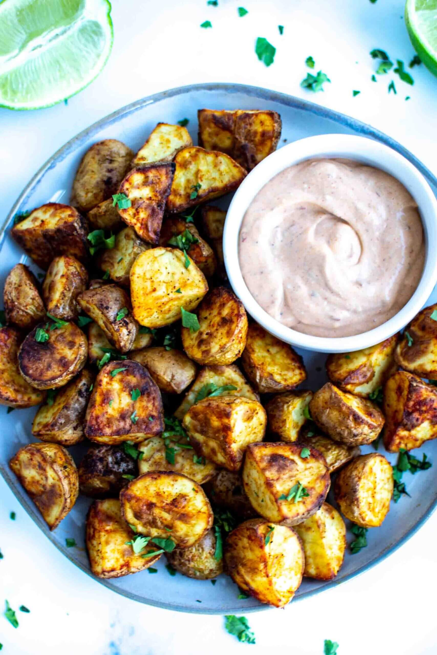Roasted potatoes on a plate withg chipotle mayo