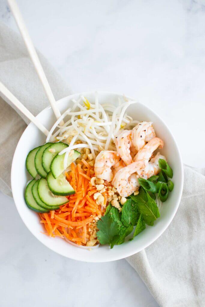 Vietnamese summer roll noodle bowl with peanuts, cucumber, fresh herbs and shrimp.