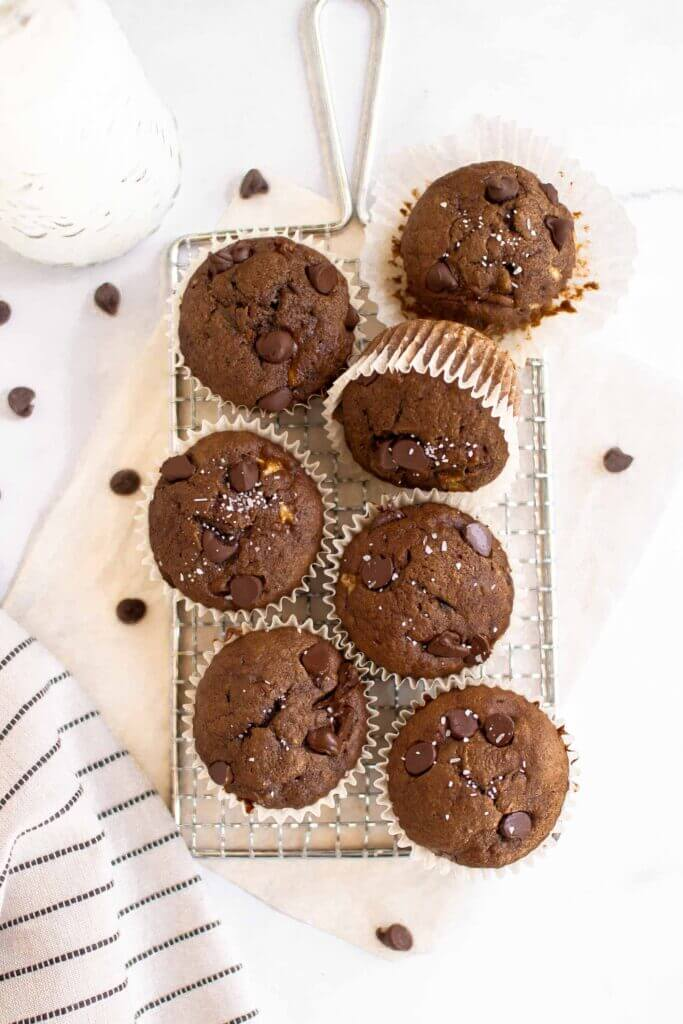 Easy double chocolate banana muffins on a tray with milk