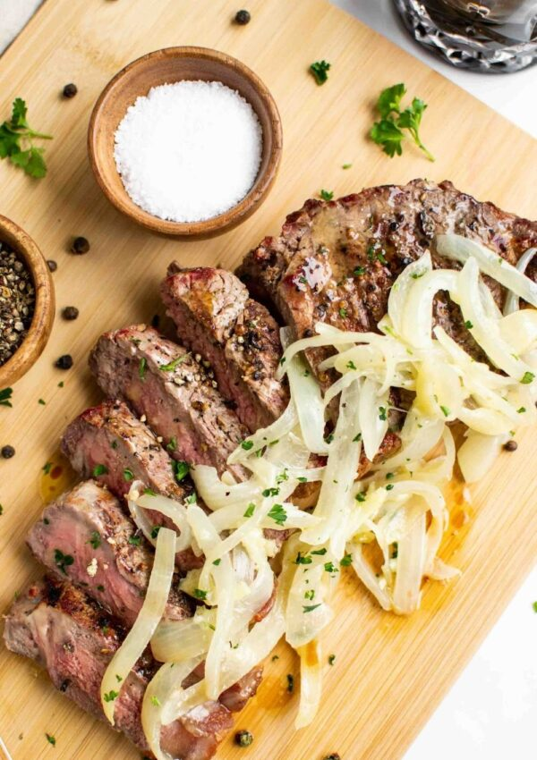 Grilled Steak with Garlic Butter Onions
