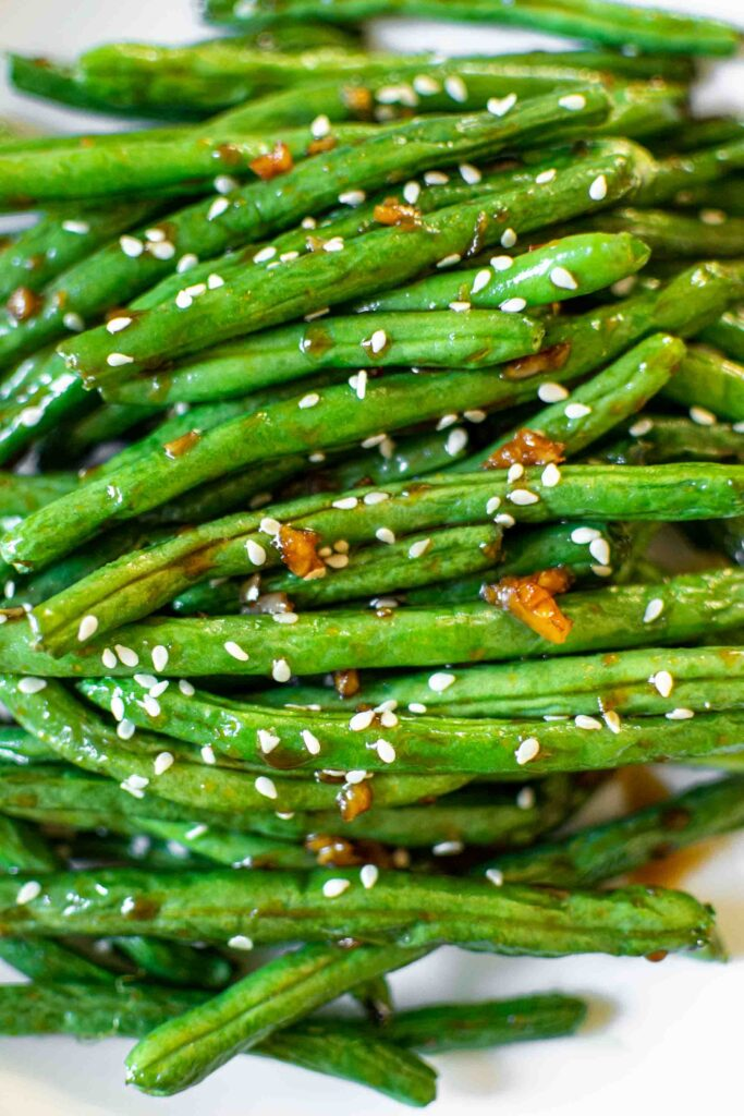 Chinese Style Air Fryer Green Beans on a plate with sesame seeds.