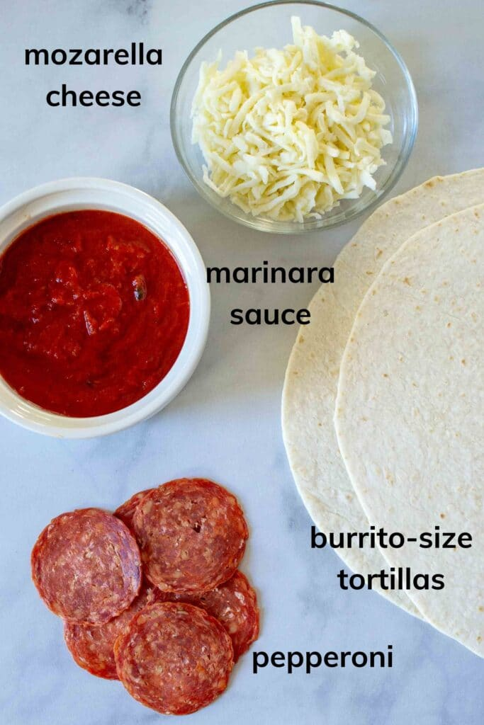 """All ingredients for Pizza Tortilla Wrap or """"Tortilla Trend"""" on table, labeled."""