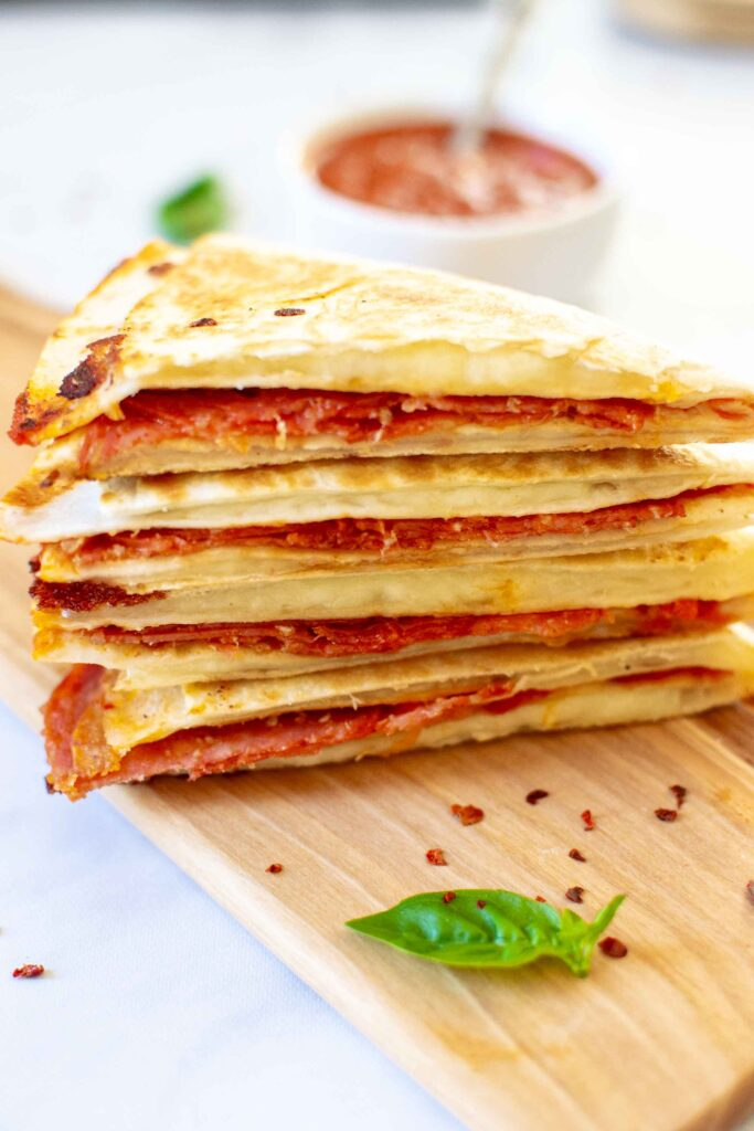 """Pizza Tortilla Wrap or """"Tortilla Trend"""" stacked on a plate"""