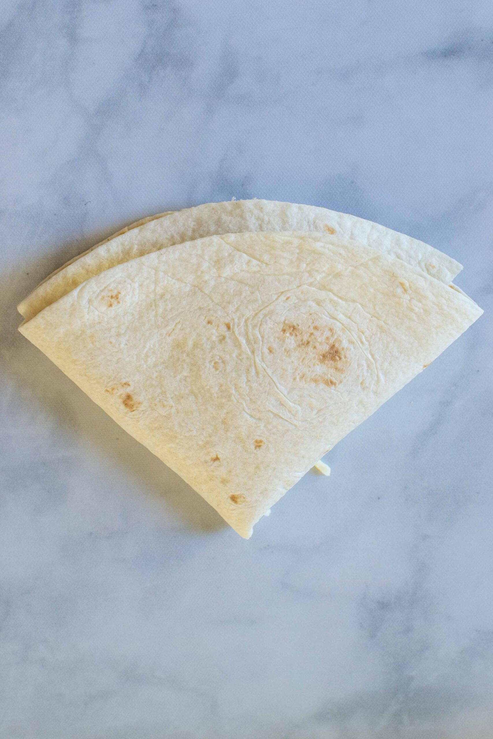 """Step 3 of making a Pizza Tortilla Wrap or Pizza """"Tortilla Trend."""" Fold it up!"""