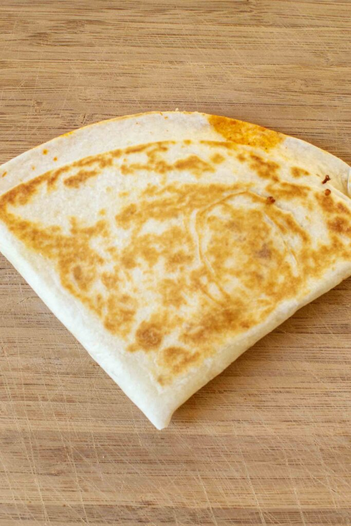 """Step 5 of making a Pizza Tortilla Wrap or Pizza """"Tortilla Trend."""" Fry it up until it's golden brown and cheese is melted."""