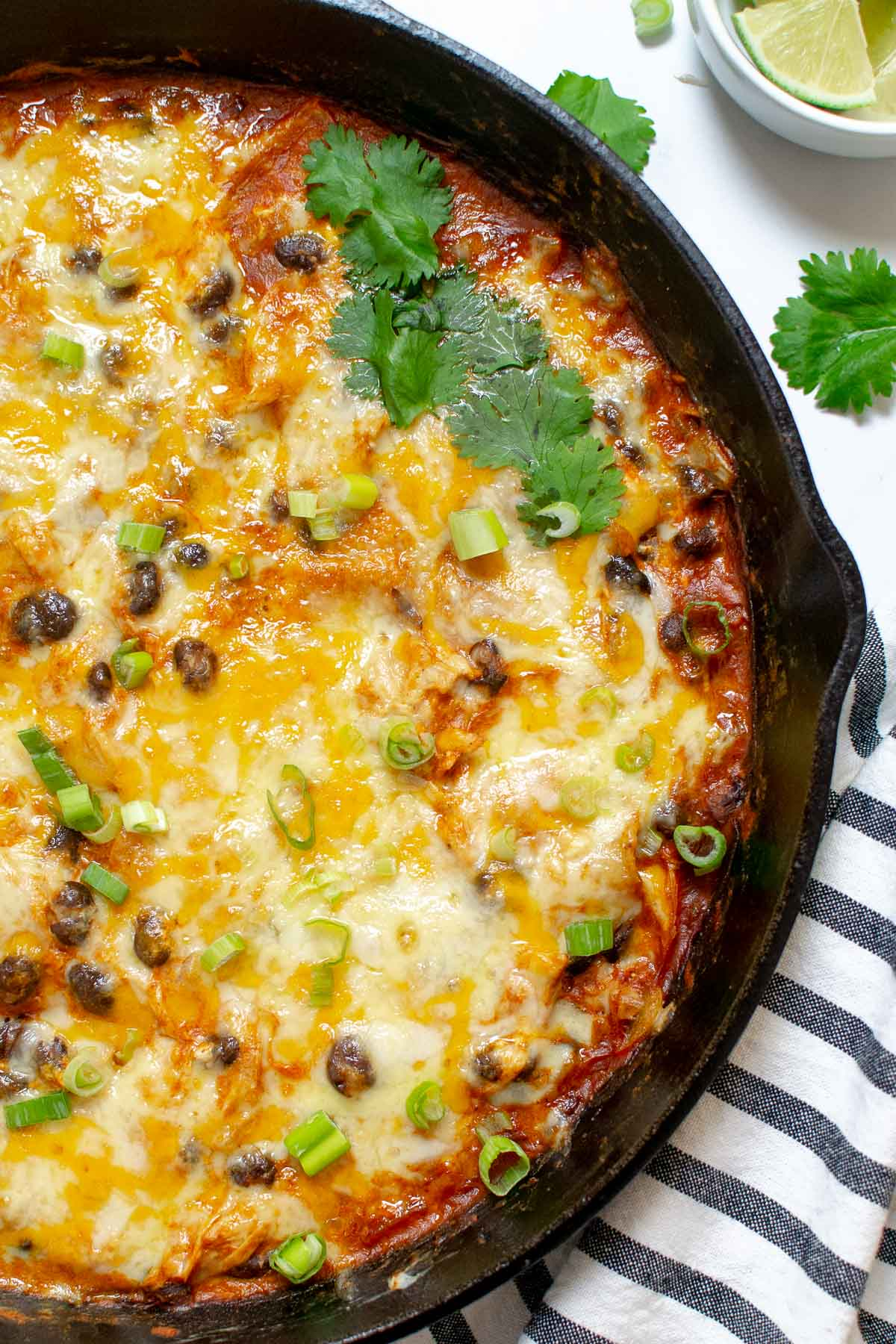 Chicken enchilada skillet in a cast iron pan with cilantro