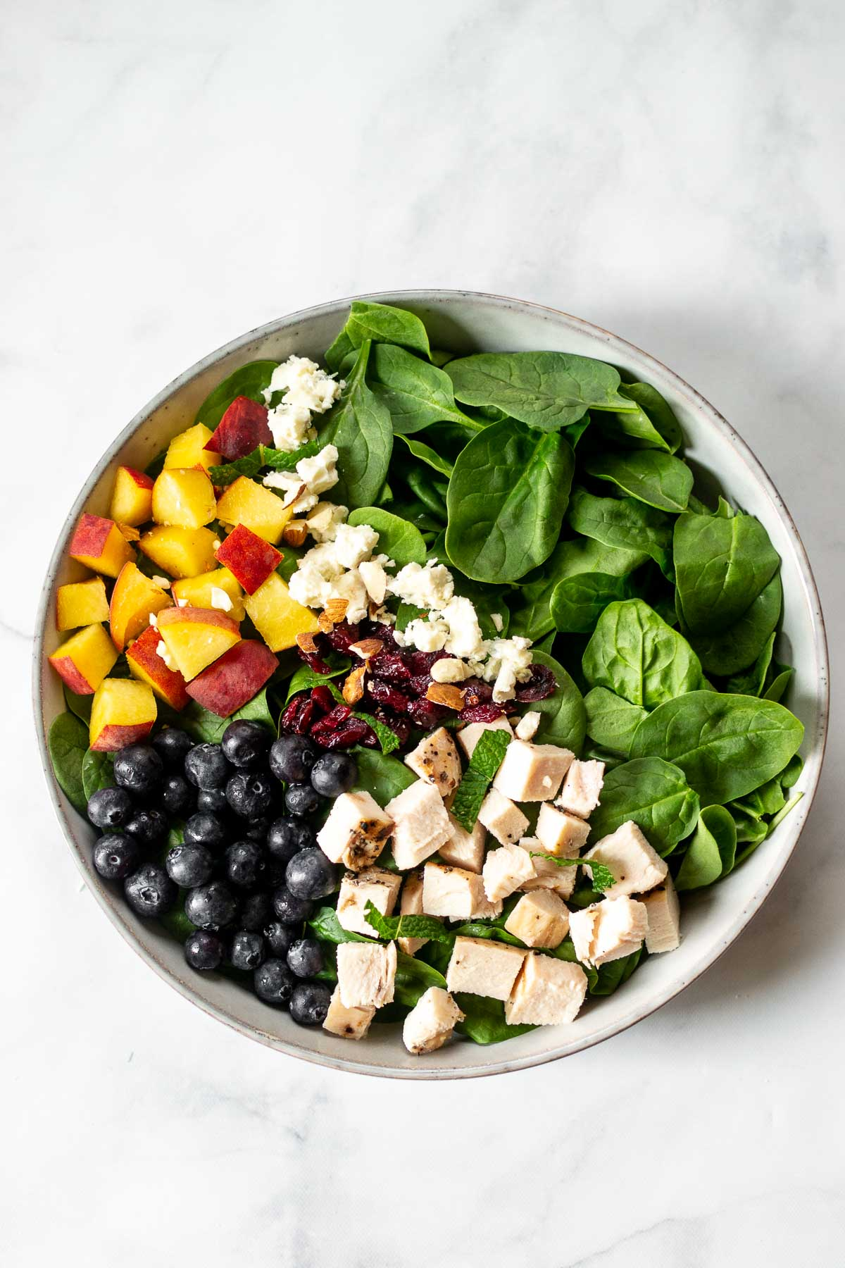 All of the salad ingredients in one bowl