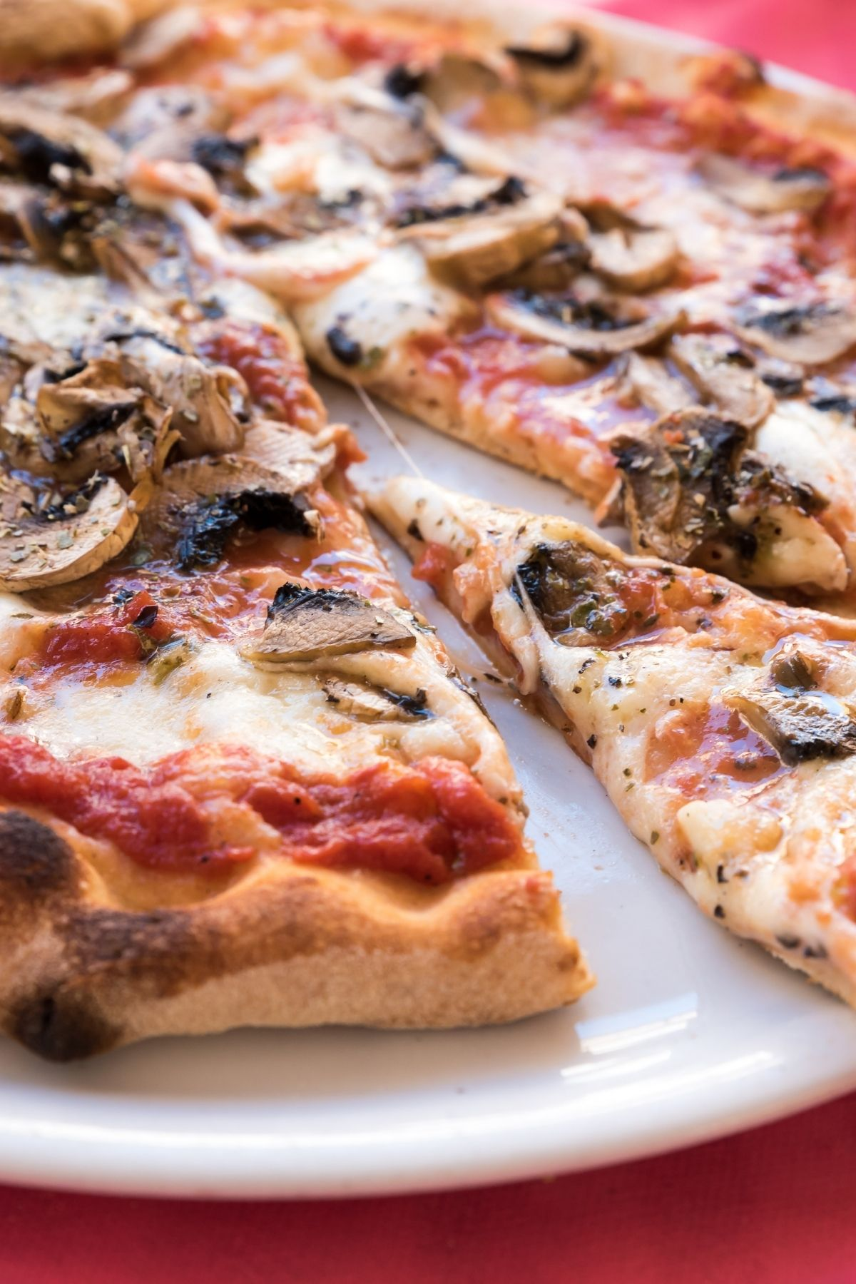 A cheese pizza topped with mushrooms.