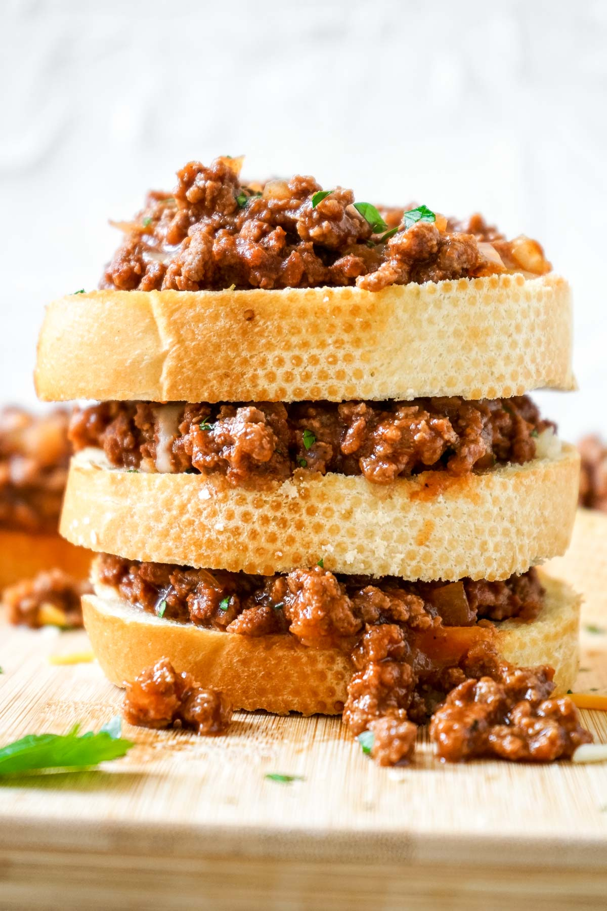 Three slices of Texas toast sloppy joes stacked on top of each other.