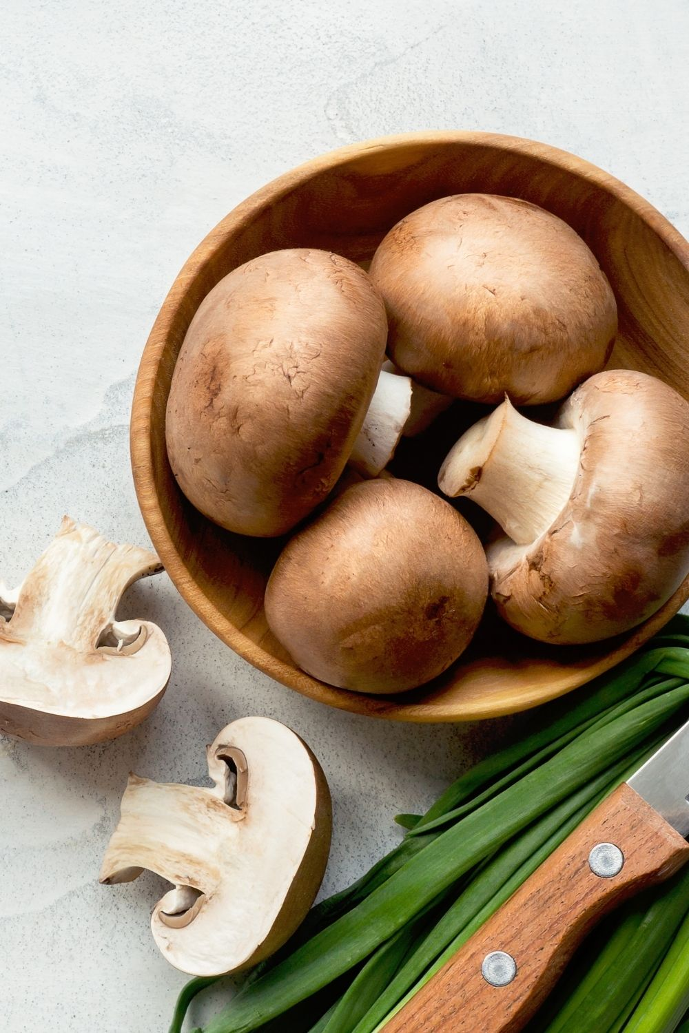 Bowl of mushrooms on a table.