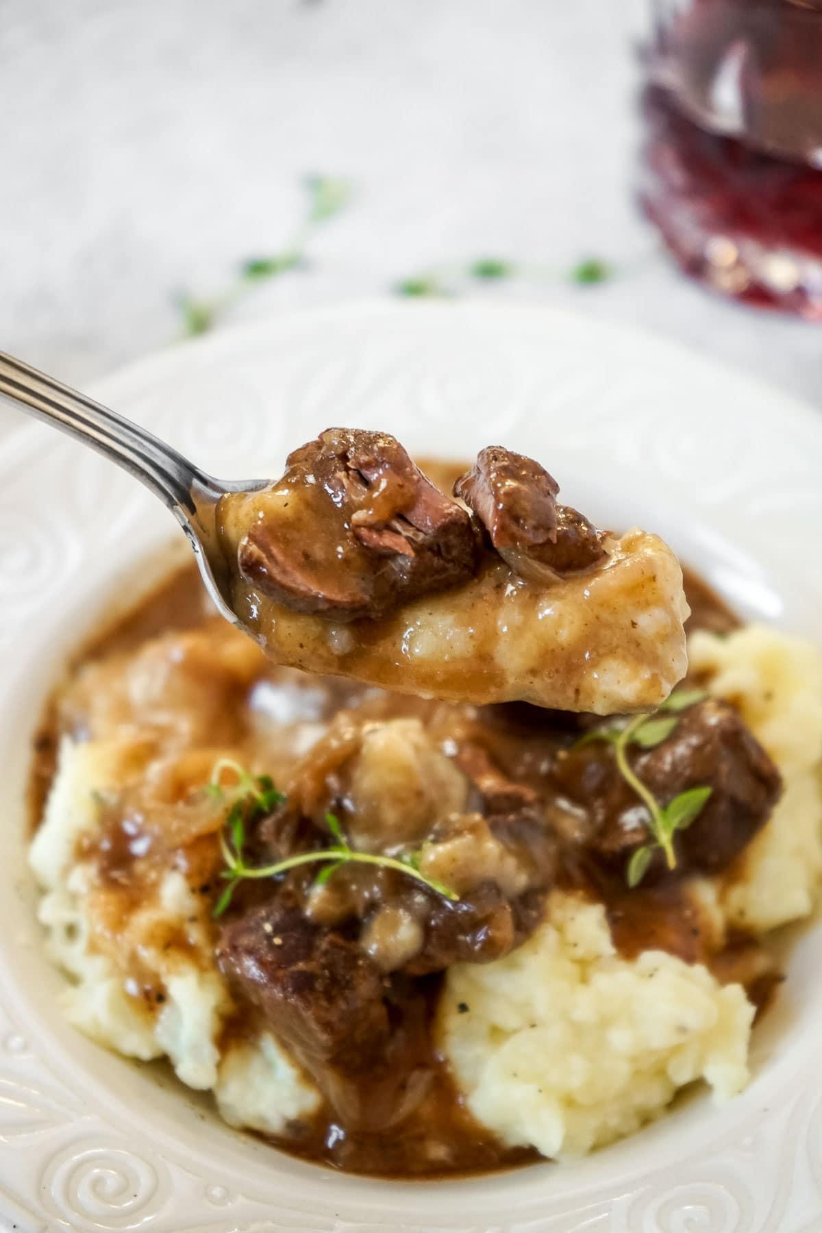 Close up of a fork with beef tips in gravy cooked in the instant pot.