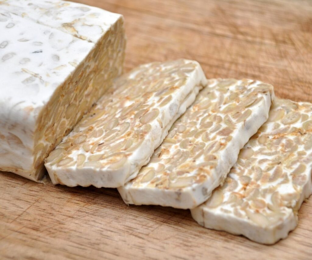 Tempeh cut into thick slices.