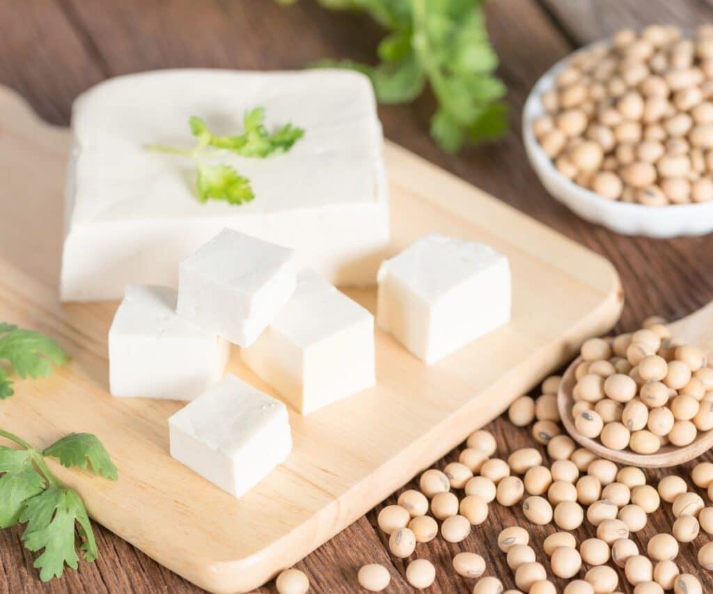 Tofu on a cutting board.
